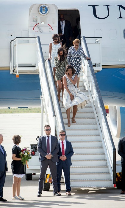 Michelle had a Marilyn Monroe moment as she disembarked Air Force One, holding down her summer dress.