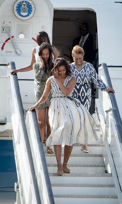 The first lady cautiously made her way down the exit steps with her daughters Malia and Sasha Obama, as well as her own mother, Marian Shields Robinson.