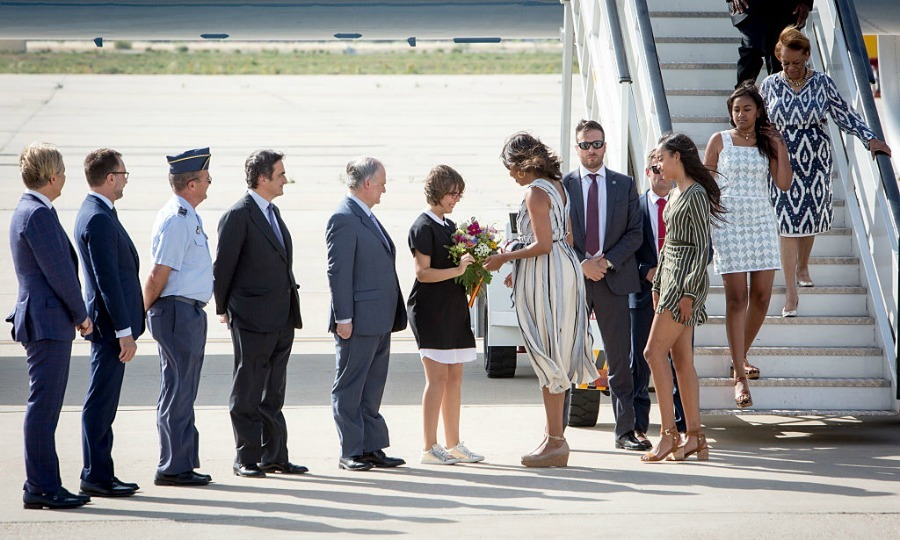 Michelle was greeted with a bouquet of flowers upon her arrival to Madrid.