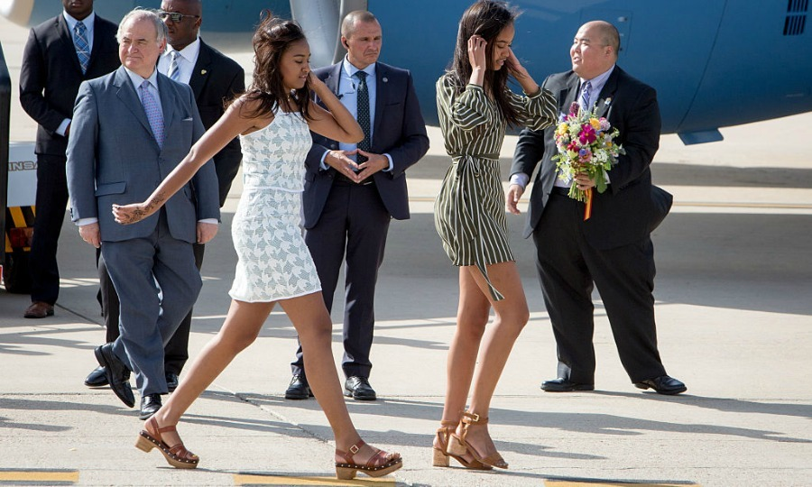 The Obama girls looked summer ready arriving to Madrid's airport in mini dresses and sandals.