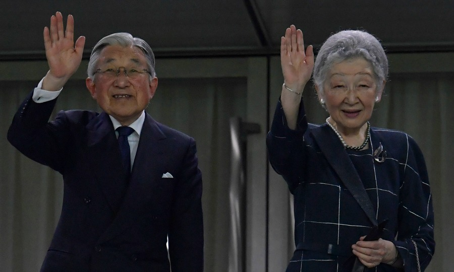 Emperor Akihito and Empress Michiko waved to an audience during the international friendly match between Japan vs. Scotland at Ajinomoto Stadium in Tokyo.