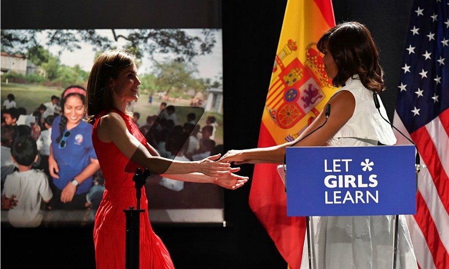 The first lady welcomed the Spanish Queen on to the stage at the conference in Madrid.
