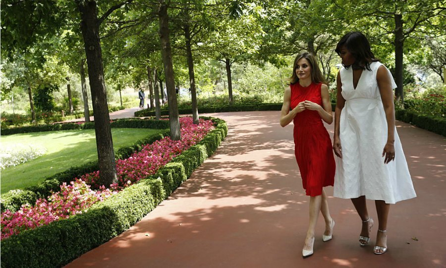 The monarch was a vision in red stepping out in a Nina Ricci dress. Letizia completed her look wearing nude court heels and her hair sleek. Meanwhile, Michelle paid homage to Spain in a white DELPOZO summer dress that she teamed with stylish metallic sandals.