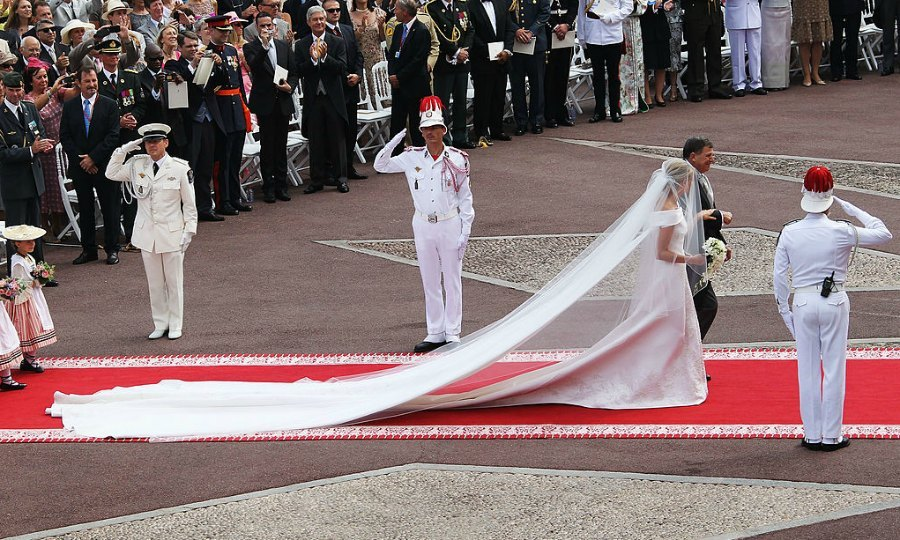 The bride's show-stopping gown featured a five-meter-long train that was adorned with 40,000 Swarovski crystals and 20,000 mother-of-pearl teardrops.