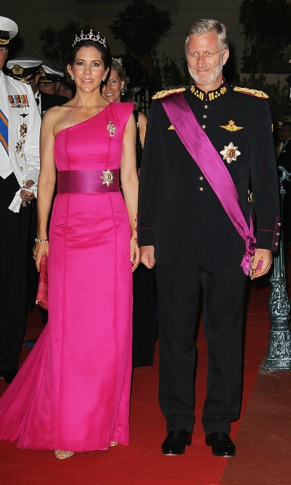Princess Mary of Denmark and Prince Philippe of Belgium attended the official dinner and firework celebrations at the Opera Terraces in color-coordinated fuchsia ensembles and accents, following the couple's religious ceremony.