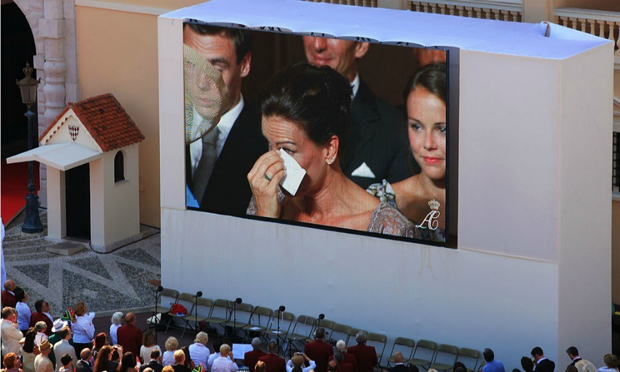 Seen on the giant scren in the Palace courtyard, Princess Stephanie wiped away tears during Albert and Charlene's civil vows.