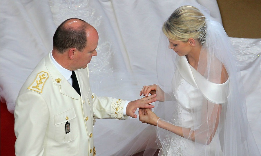 She put a ring on it! Charlene placed the wedding band on her husband's finger during their courtyard wedding.