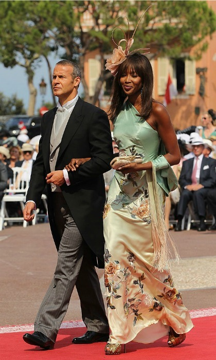 Supermodel Naomi Campbell turned the aisle into a runway, walking on the arm of businessman Vladislav Doronin into the royal couple's religious ceremony.
