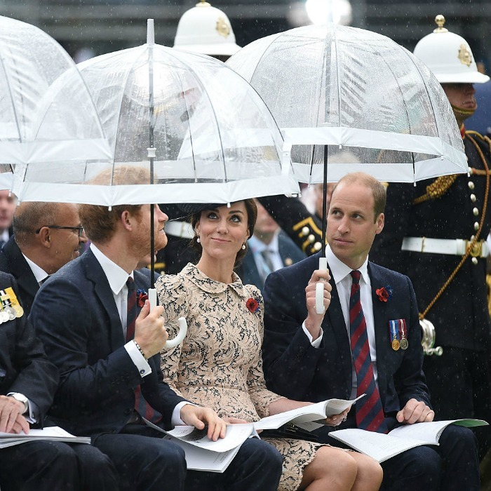 Chivalrous brothers! Princes William and Harry kept Kate dry from the rain, holding up umbrellas during a centenary service at the Commonwealth War Graves Commission Thiepval Memorial.