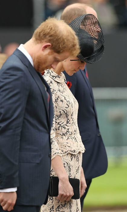 Harry and Kate bowed their heads in silence at the 100th anniversary service at the Thiepval memorial to the Missing.