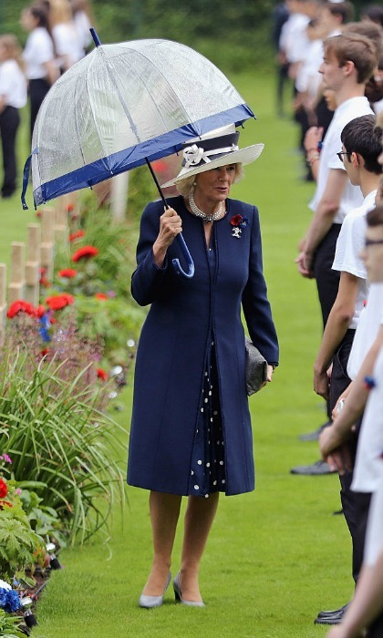 The Duchess of Cornwall donned a navy, dotted dress, which she paired with a matching coat for the royal family visit to France.
