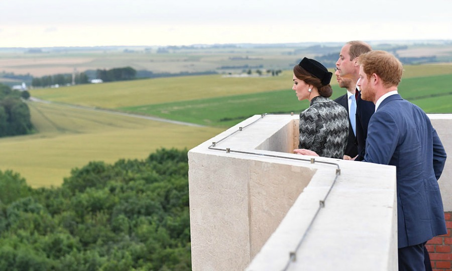 The royal peered over the ledge of the 150-foot high memorial in France.
