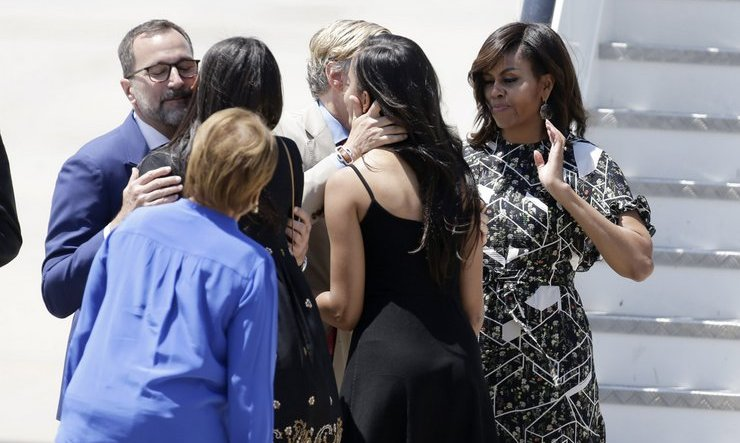 The family shared hugs with Ambassador James Costos and his husband Michael S. Smith as they prepared to depart. 