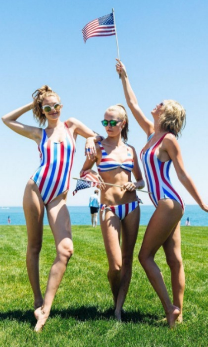 Gigi Hadid, Cara Delevingne and Taylor Swift channeled their inner pinup girl in patriotic Solid and Striped suits.