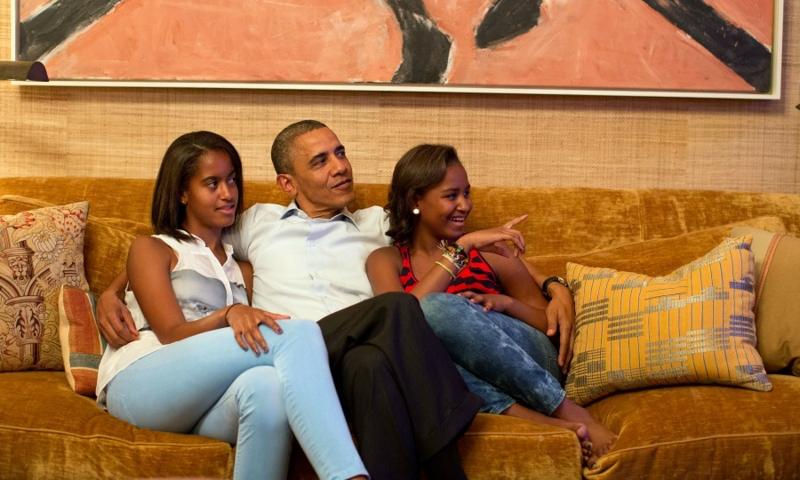 2012: Barack, Sasha and Malia cozied up to watch Michelle Obama deliver a speech at the Democratic National Convention. 