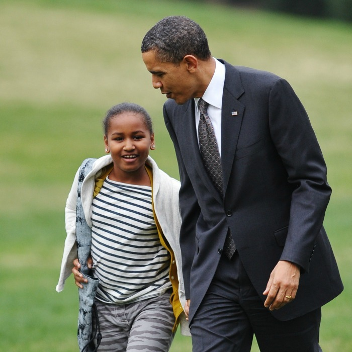 2011: Sasha ran to greet her father on the South Lawn when he touched down at the White House after a five day trip to Latin America. 