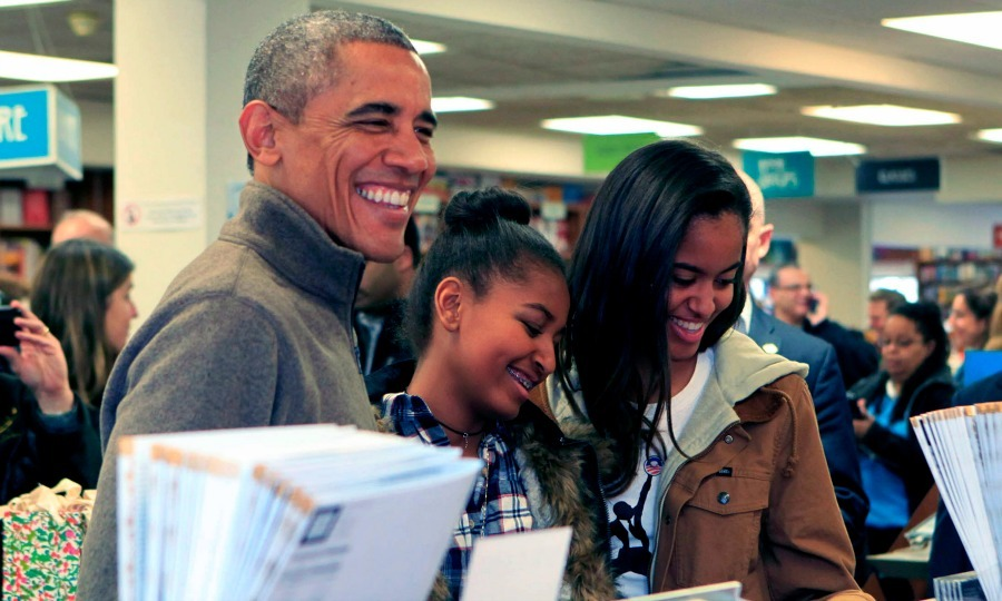 Barack, Malia and Sasha were all smiles as they shopped for books at Politics and Prose bookstore during Small Business Saturday in Washington, D.C.