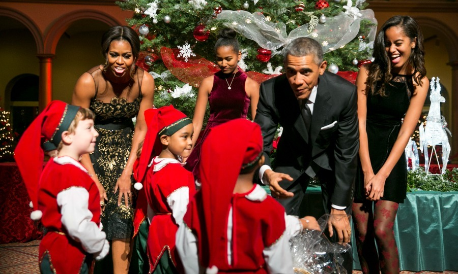Barack, Malia and Sasha were their dad's little helpers during the taping of <i>Christmas in Washington</i>. 