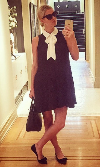 While pregnant with daughter Lily Grace, who was born in July 2016, Nicky channeled her inner Wednesday Addams wearing a black sleeveless dress that featured a white collar and bow necktie. The expectant mom accessorized her chic look with black flats, sunglasses and an Hermès purse.