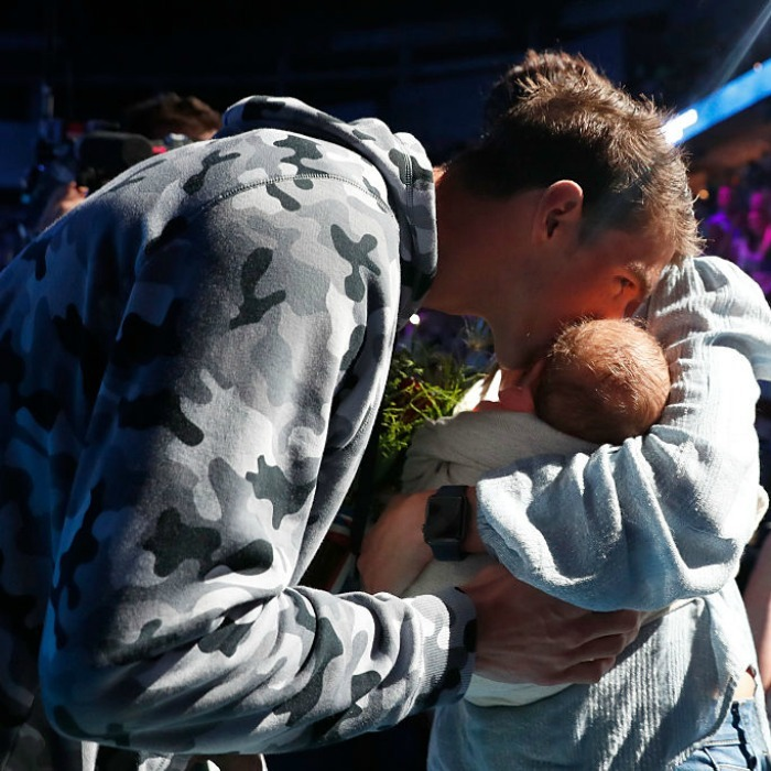 The gold medalist planted a kiss on his son after coming in first during an Olympic trial.