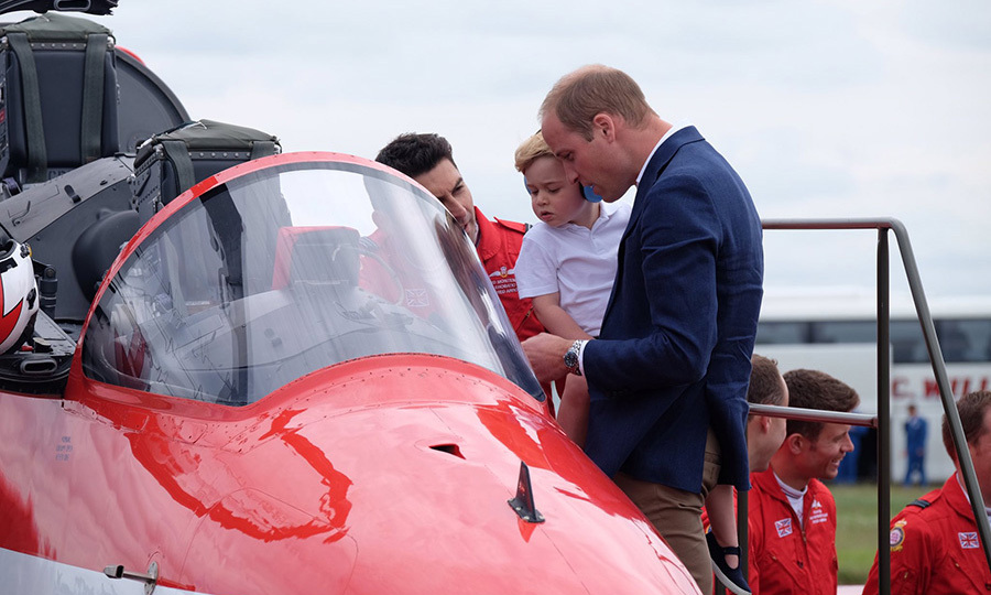 It was hard to tell who was more fascinated as the father-son team checked out a Red Arrow jet during George's first ever UK royal engagement in July 2016.