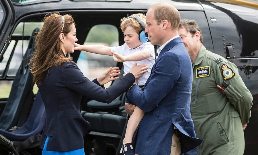 Come to mommy! George reached out for Kate, while touring the aircrafts.
