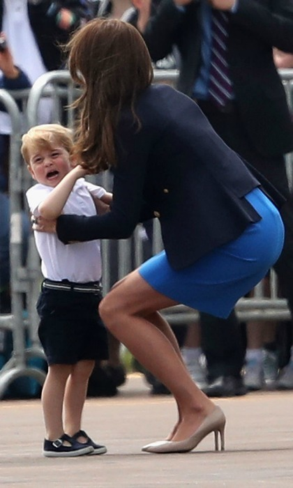 George appeared to be overwhelmed by everything taking place initially, so the Duchess scooped up her crying little boy. 