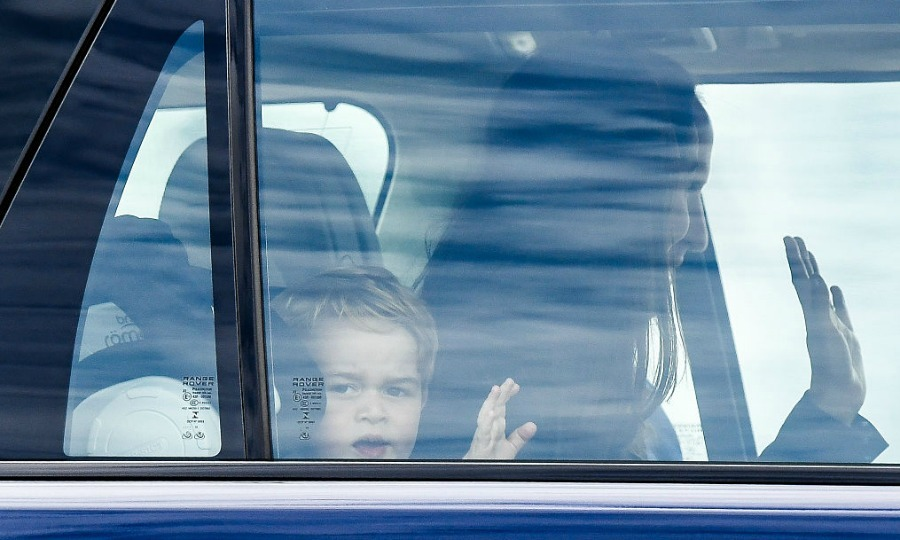 A royal wave! George motioned to fans from his carseat as he arrived for his afternoon at the Royal International Air Tattoo.