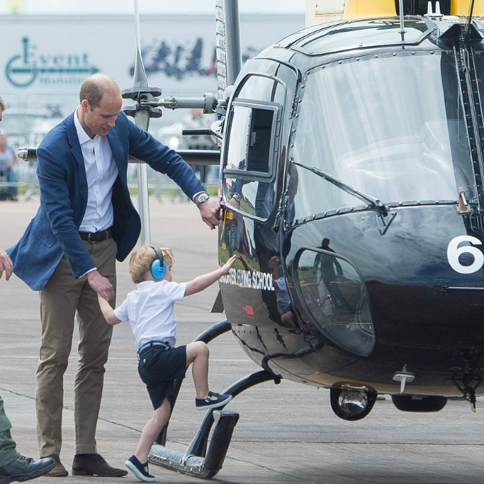 The Duke of Cambridge lent his son a hand as he made his way into a helicopter.