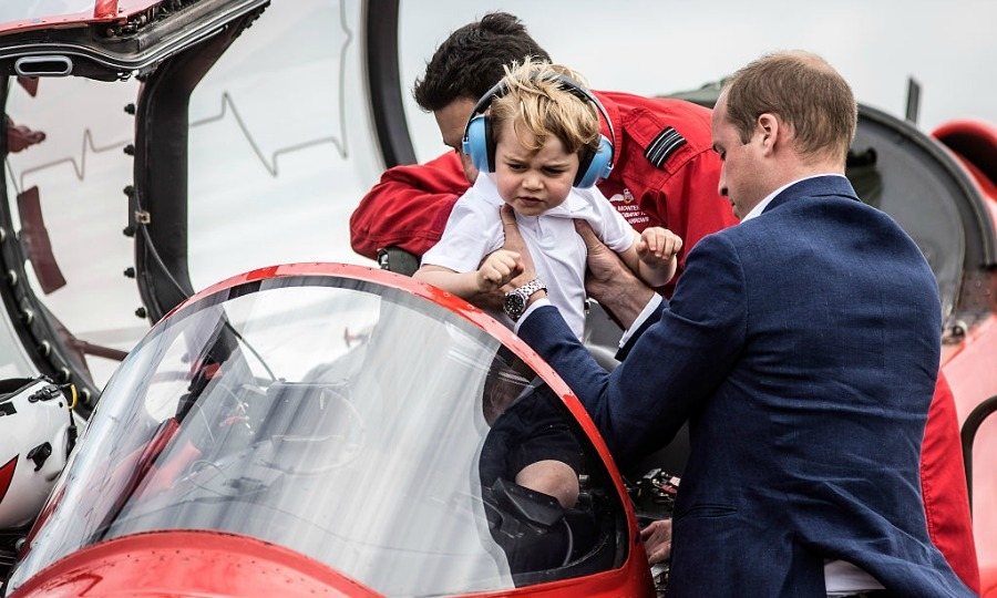 A pilot for a day! George hopped into the cockpit of a Red Arrow Hawk with a little help from Prince William.