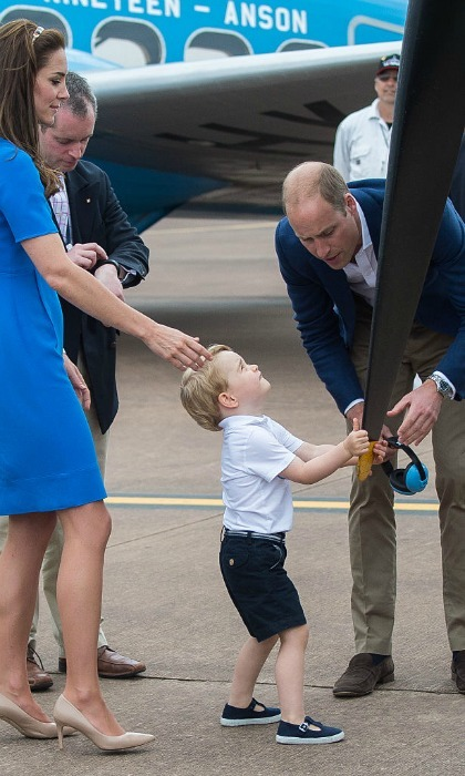 Not only did Prince George get to sit in a cockpit, but he also got to touch the propeller of a plane, with of course his mom standing close.