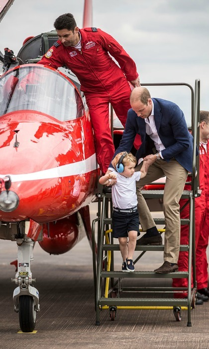 After showing off his pilot skills, George disembarked the plane with Prince William.