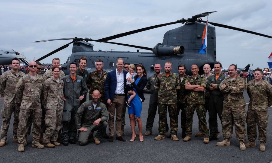 Say cheese! The royal trio posed for a group photo with the Chinook Display Team.