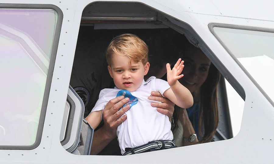 The royal tot gave fans a wave from the window of a cockpit.