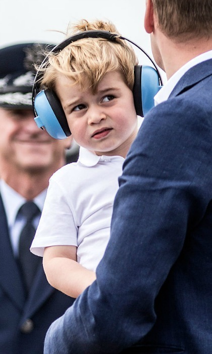 The future King looked adorable wearing blue ear protectors  to guard him from the overhead jets noise.