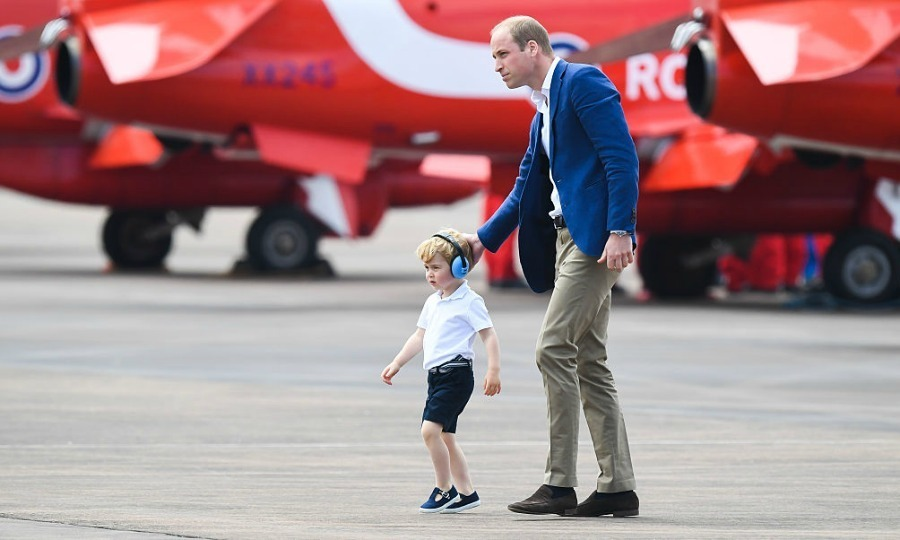 George appeared confident walking the tarmac with his father.