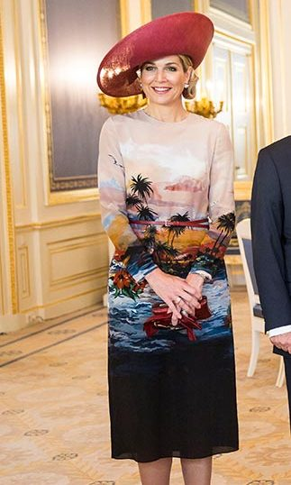 Queen Maxima's scenic print dress turned heads as she welcomed the Greek president to the Netherlands.