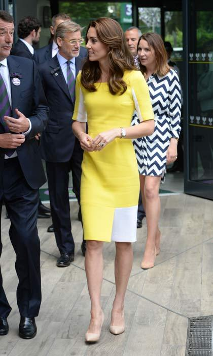 Standing out from the crowd at Wimbledon, Kate rewore this bright yellow and white Roksanda Ilincic dress to watch the tennis quarter finals from the royal box.