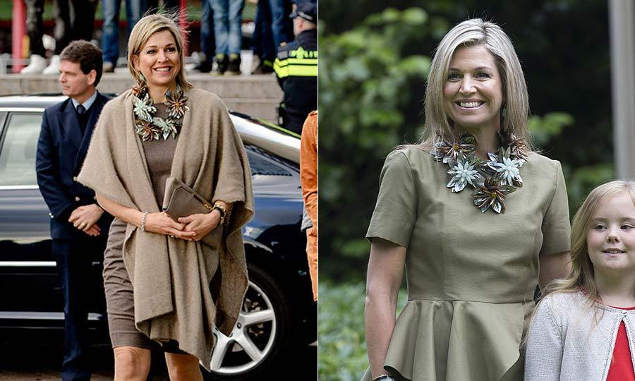 The Dutch Queen took two brown outfits from drab to fab with the simple addition of a large brown and blue floral necklace.