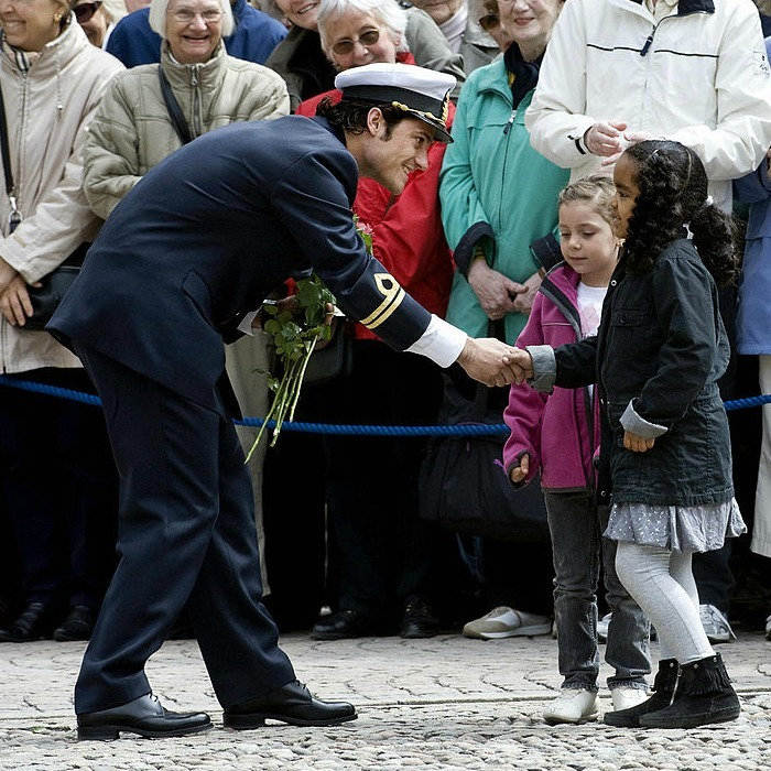 "Pleased to meet his acquaintance! Sweden's <a href=""https://us.hellomagazine.com/tags/1/prince-carl-philip/""><strong>Prince Carl Philip</strong></a> greeted two young girls during his 30th birthday celebrations in 2009.