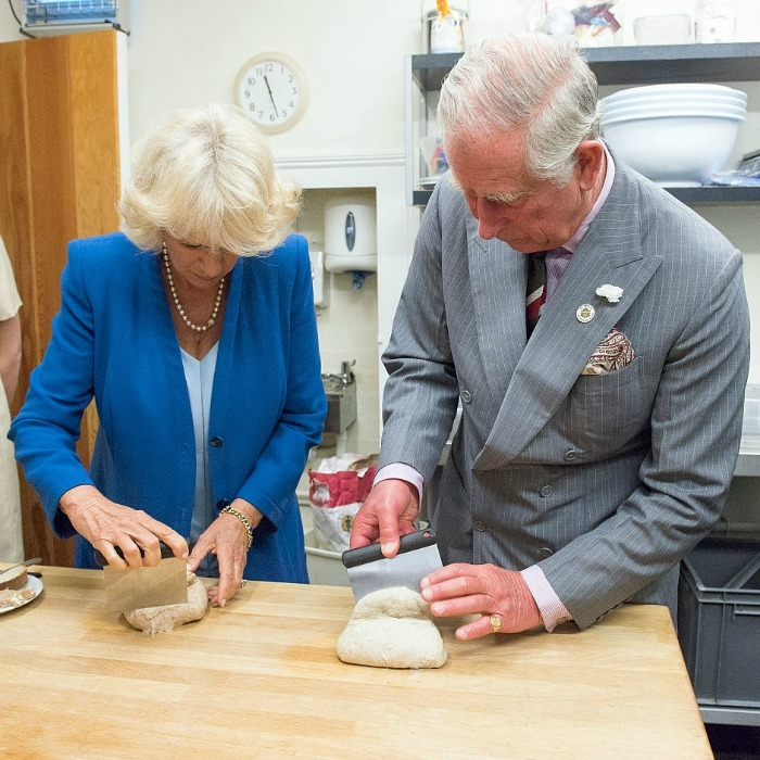 "<a href=""https://us.hellomagazine.com/tags/1/duchess-of-cornwall"" target=""_blank""><strong>The Duchess of Cornwall</strong></a> and <a href=""https://us.hellomagazine.com/tags/1/prince-charles"" target=""_blank""><strong>Prince Charles</strong></a> stepped into the kitchen for a bread making session while touring the Talgarth Mill to learn more about how flour and bread are made at the Wales site. 