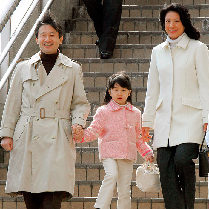 Pretty in pink. The little Princess held on tightly to her father's hand as the trio arrived at the Nagano station in central Japan. The family were on their way to their annual ski trip.