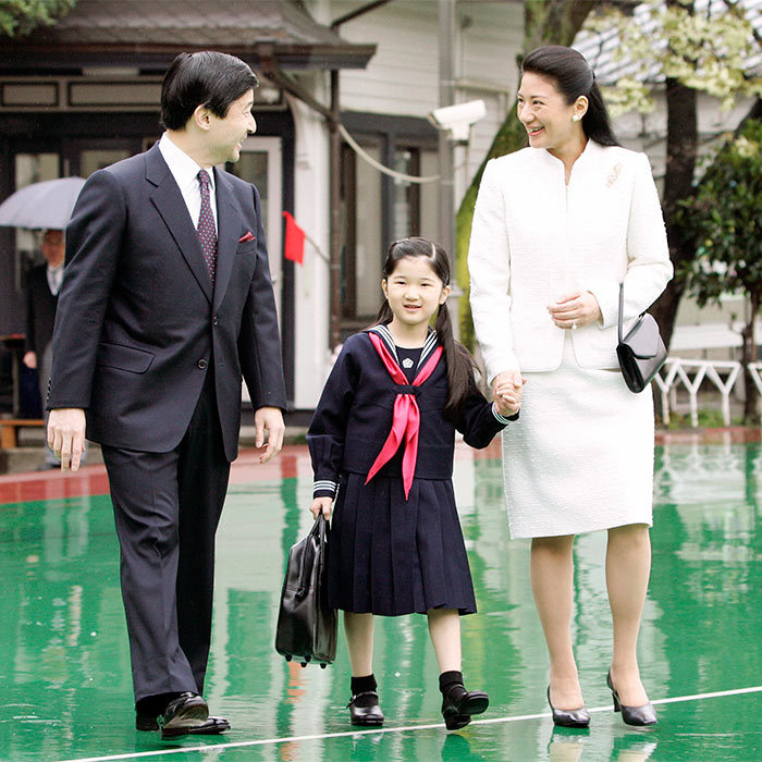 Proving that they are never too busy to walk their little girl to school, Princess Masako sweetly held hands with Aiko as the trio set off to walk to the little's Princess elementary school.