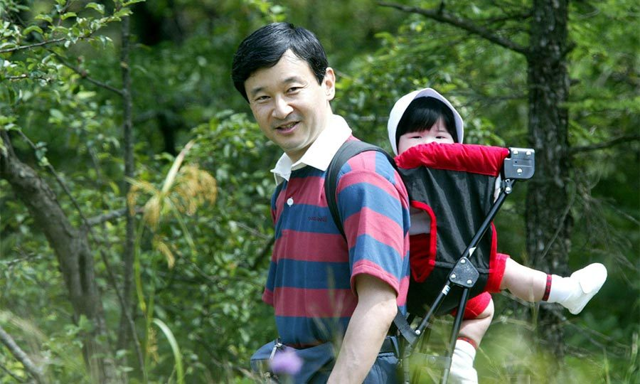 The father-daughter duo enjoyed some bonding time together during a walk in the woods on a family holiday in Tochigi Prefecture, during the summer of 2002.