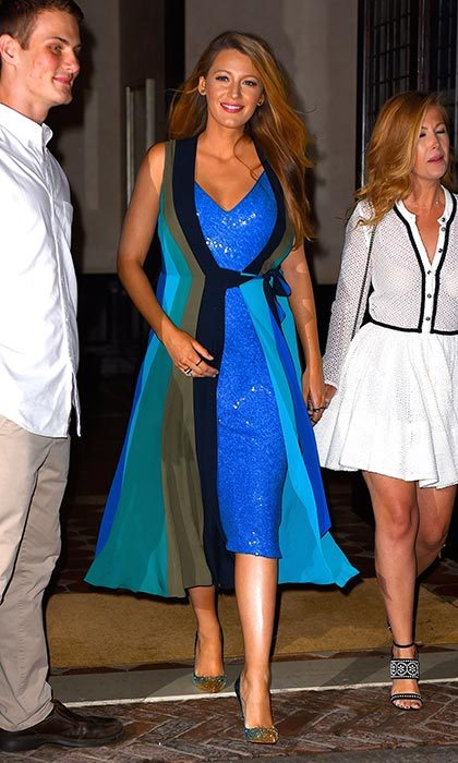 Blue beauty! After a quick change out of her beautiful peach dress, Blake dressed up her bump in a shimmering blue midi-dress as she headed out for the night in New York City.