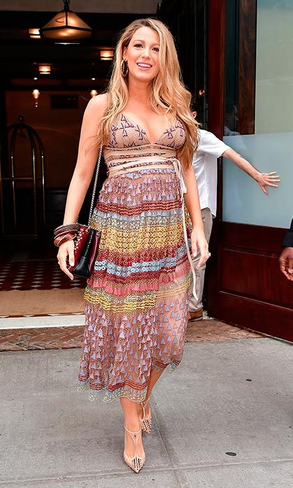 Blake continued to reign supreme as the Queen of maternity wear, when she stepped out wearing a multi-colored sheer dress for day two of the <i>Café Society</i> press tour.