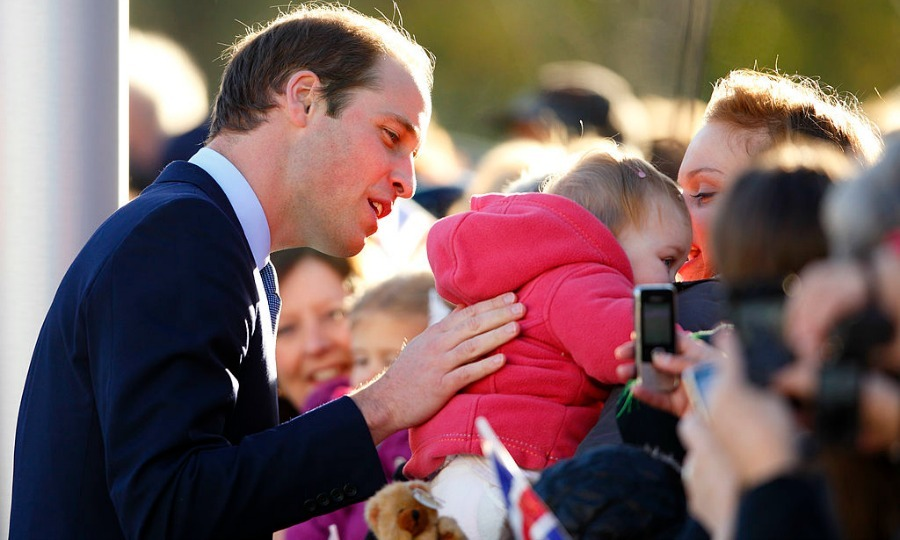 Come to William! The Duke of Cambridge tried to win the attention of a little girl during a walkabout in 2013.