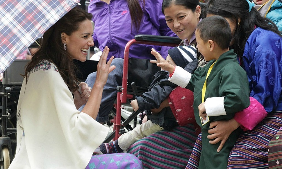 It was nothing but friendly waves all-around for Kate at a Bhutanese archery demonstration in 2016 during her and Prince William's royal tour of Bhutan. 
