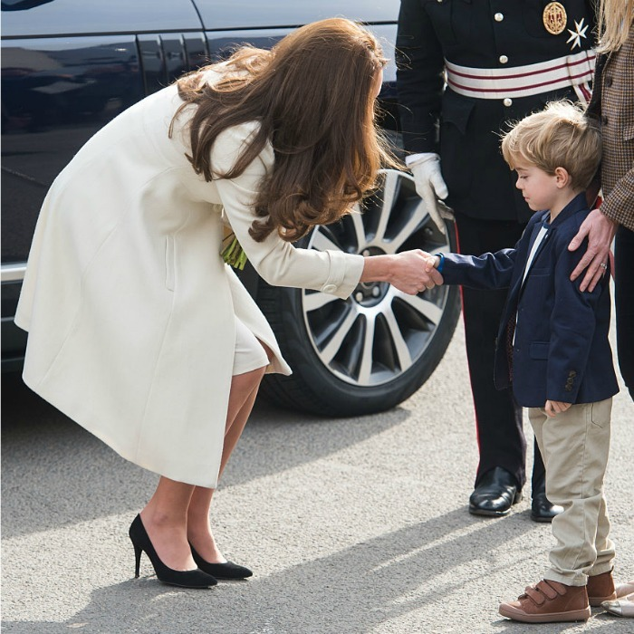 Suspicious of the Duchess. A little boy cautiously watched Kate Middleton shake his hand as she toured the set of Downton Abbey at Ealing Studios in 2015.