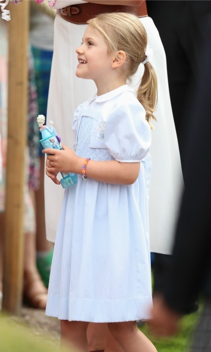 As well-wishers showered her mom with gifts, Princess Estelle held on to her <i>Frozen</i>Elsa toy.